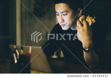 Men eating rice while working 61785472