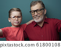 Close-up grandfather and grandson in glasses 61800108