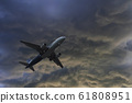 Airplane over the clouds 61808951
