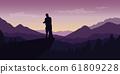couple enjoy the mountain view at purple landscape 61809228