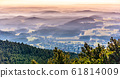 Hilly landscape in the mist under Jested Mountain. Weather temperature inversion, Czech Republic 61814009