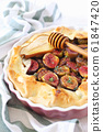 Homemade figs and pears tart galette with honey 61847420