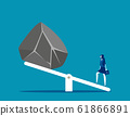 Woman with huge stones on seesaw. Concept business 61866891