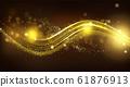 Gold sparkle wave on black blurred background. 61876913