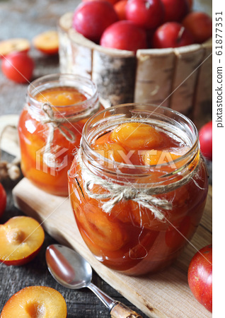 Autumn sweet. Homemade red plums jam in two jars 61877351