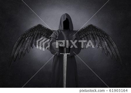 Dark angel with medieval sword in the dark 61903164