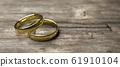 gold wedding rings on wooden table soft focus macro shot 3d render illustration 61910104