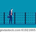 Man and fence barbed wire. Concept business 61921665