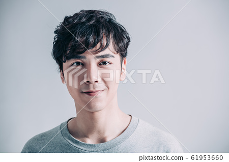 portrait of young smiling handsome man isolated on 61953660