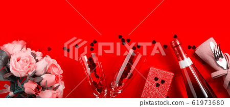 Romantic dinner concept flat lay on red background 61973680