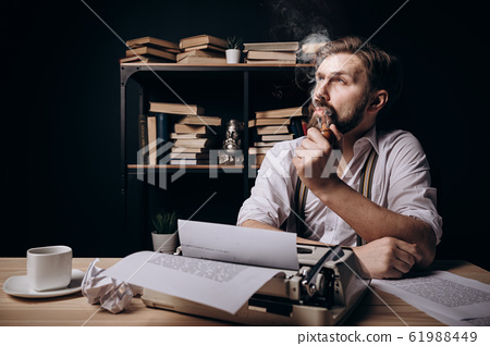Handsome Bearded Writer Thinking and Smoking Pipe 61988449