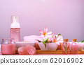 Spa composition with bowls with salt, flowers, towel, candle, crystals, soap and lotions 62016902