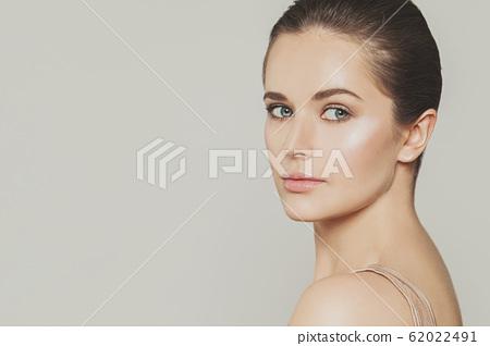 Female face close up. Beautiful model girl 62022491