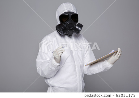 Male scientist in protective suit and antigas mask with glasses. 062 62031175