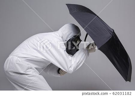 Male scientist in protective suit and antigas mask with glasses. 060 62031182