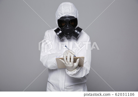 Male scientist in protective suit and antigas mask with glasses. 053 62031186