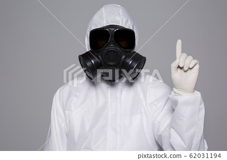 Male scientist in protective suit and antigas mask with glasses. 043 62031194