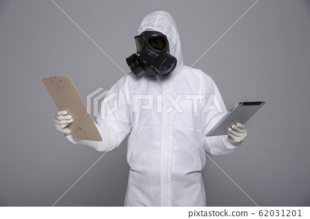 Male scientist in protective suit and antigas mask with glasses. 029 62031201