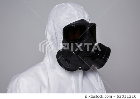 Male scientist in protective suit and antigas mask with glasses. 009 62031210