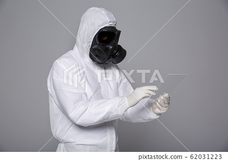 Male scientist in protective suit and antigas mask with glasses. 068 62031223