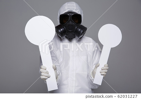 Male scientist in protective suit and antigas mask with glasses. 054 62031227