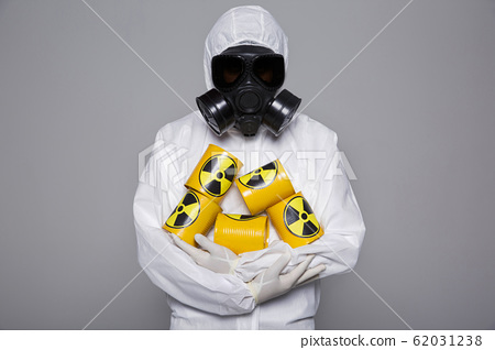 Male scientist in protective suit and antigas mask with glasses. 051 62031238