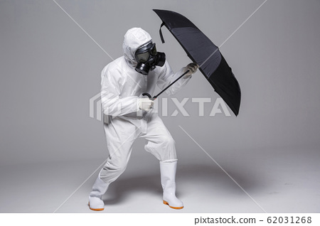 Male scientist in protective suit and antigas mask with glasses. 046 62031268