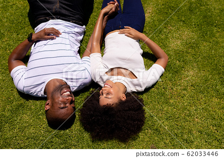 Happy Young couple relaxing in the garden 62033446