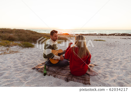 Couple enjoying free time at the beach 62034217