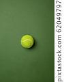 Sport equipment isolated on green studio background 62049797