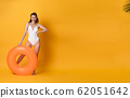 young woman dressed in swimwear with rubber ring 62051642