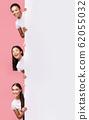 Three Girls Peeking Out Of Blank Board Posing, Pink Background 62055032
