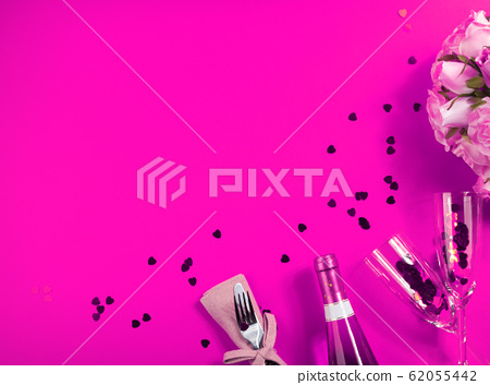 Romantic dinner concept flat lay on pink background 62055442