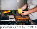 Obese woman recording video cooking healthy food 62061916