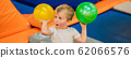 Little boy with a ball on trampolines BANNER, LONG FORMAT 62066576