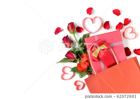 Red gift box and red rose with red heart ribbon in 62072691