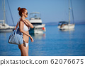 WOman at the seaside. Adriatic, yachts in the 62076675
