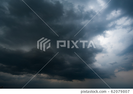dark storm clouds with background,Dark clouds before a thunder-storm. 62079807