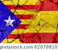 flag of Catalonia on crack cement to communicate the split between Spain and Catalan country 62079810