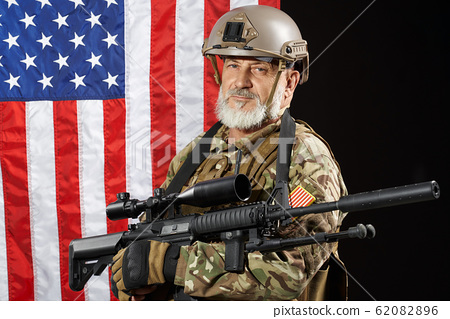 Old military officer holding sniper rifle. 62082896