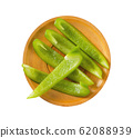 Green bell pepper slices on plate 62088939