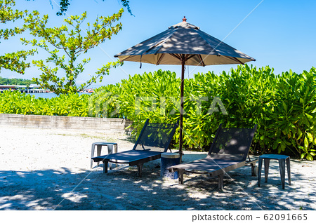 Umbrella and chair on the beach and sea with blue sky 62091665