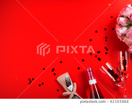Romantic dinner concept flat lay on red background 62103868