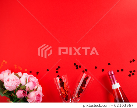 Romantic dinner concept flat lay on red background 62103967
