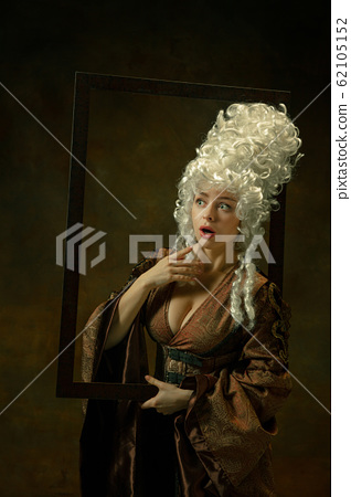 Medieval young woman in old-fashioned costume 62105152