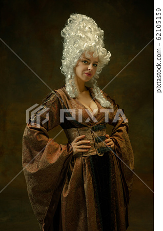 Medieval young woman in old-fashioned costume 62105159