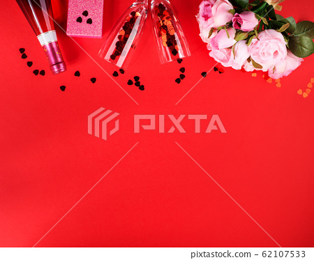 Romantic dinner concept flat lay on red background 62107533