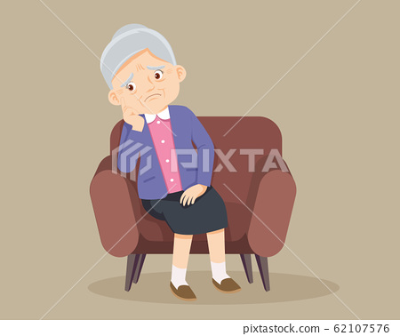 Senior woman sitting alone on sofa 62107576