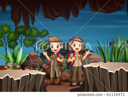 Cartoon children exploring the cave 62116972