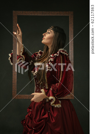 Medieval young woman in old-fashioned costume 62117863